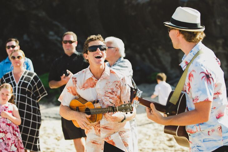 A ukulele and acoustic guitar duo called Barefoot Minded performed during the ceremony, playing upbeat island tunes, fitting of the ceremony's beachfront location.