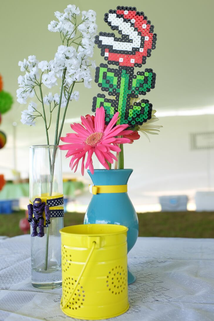 Fresh pink gerbera daisies were displayed next to perler piranha plants for the colorful, geeky centerpiece decor.