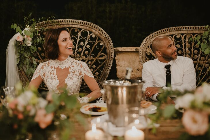 Bride and Groom in Peacock-Inspired Sweetheart Chairs