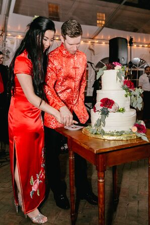 Couple Cutting Cake in Traditional Chinese Dress