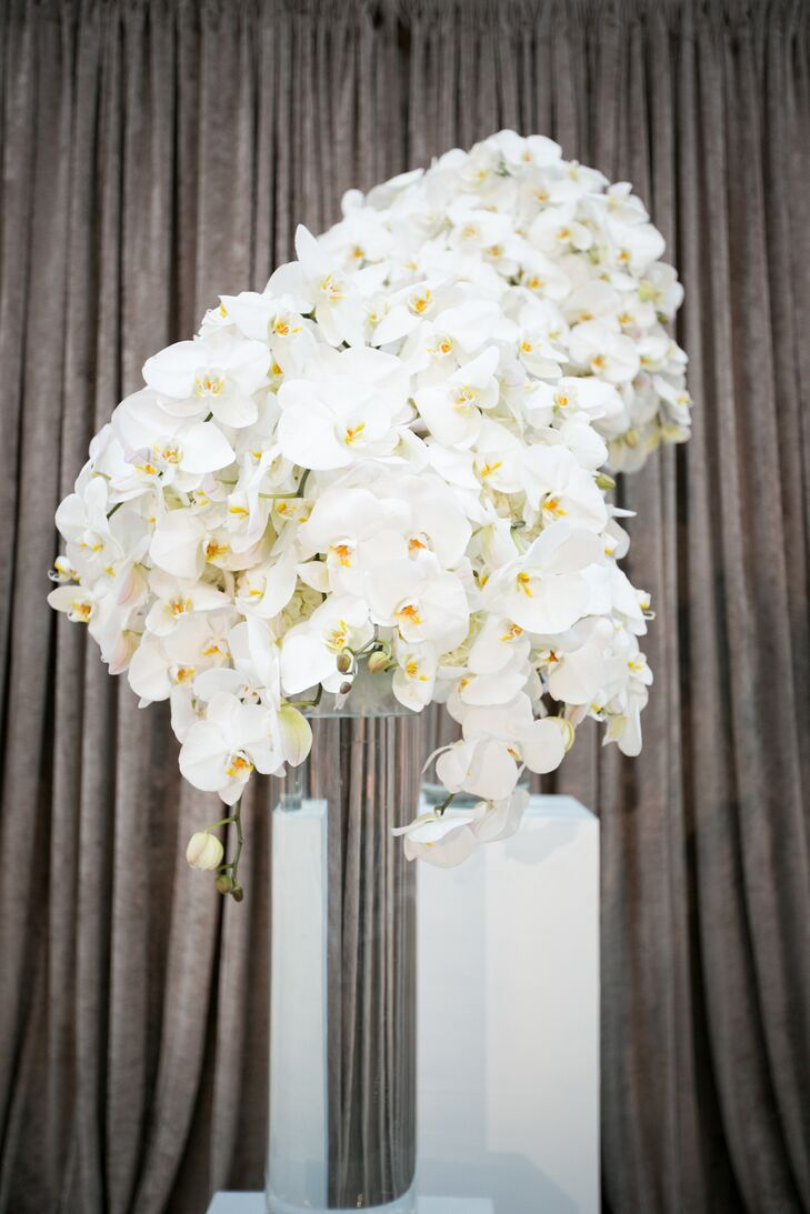Overflowing flower arrangements of white elegant orchids decorated the space throughout the day—from accenting the front of the ceremony to filling the bridal bouquet with beautiful blooms.