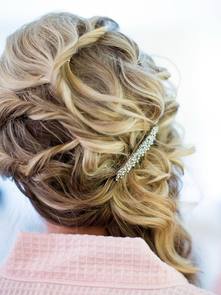 Curled bridesmaid hairstyle swept to one side