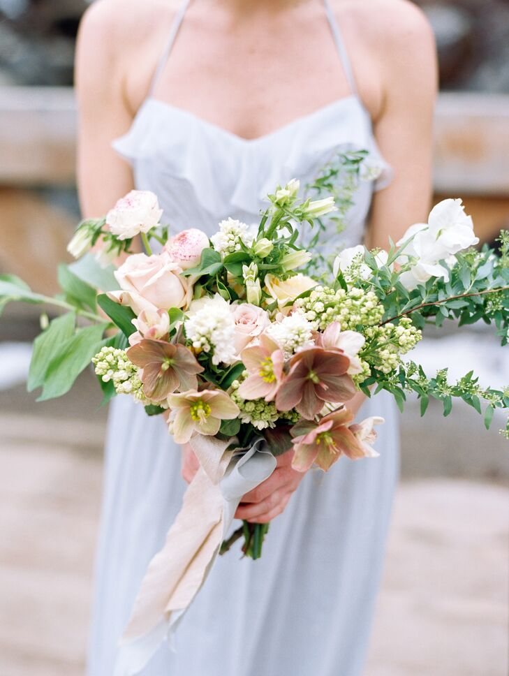 """""""I love flowers and greenery with a really wild, unkempt, romantic look,"""" Kristin explains of her in-season blooms and bunches of greenery."""