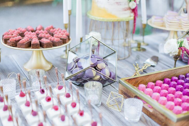 Paper Cake Events in Paso Robles created a variety of desserts in addition to the wedding cake; including vibrant pink and purple truffles, brownies, macarons and monogrammed cookies.