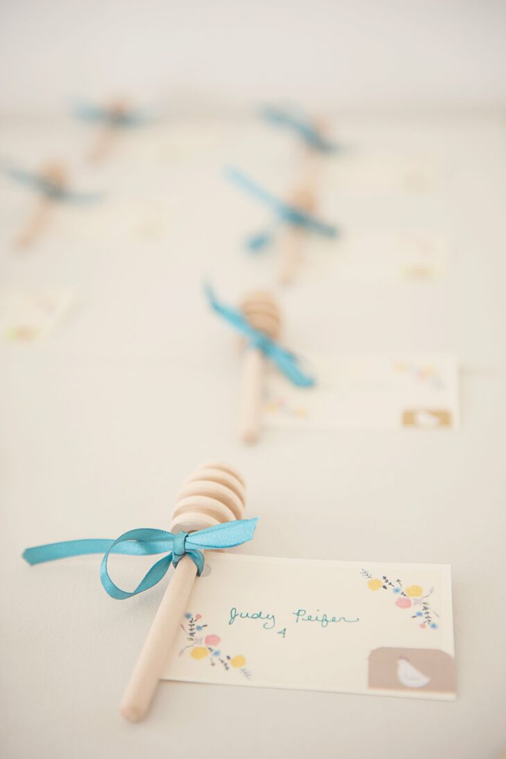Handmade tags attached to honey dippers served as escort cards, and paired with the local honey favors awaiting guests at their seats.