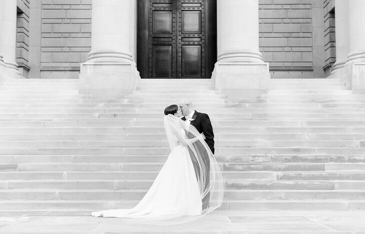 Newlyweds Kiss on the Steps of a Museum