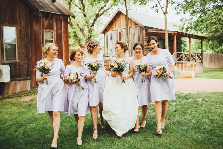 """Now this is how to do a classic look! The bridesmaids wore chic knee-length lavender satin dresses from Shabby Apple with three-quarters length. """"I wasn't sure what I wanted them to wear until I came across this dress online. The color was so beautiful and summery,"""" Rachel says. Her bridesmaids also added some personal flair to their looks with different updos and neutral or gold shoes."""