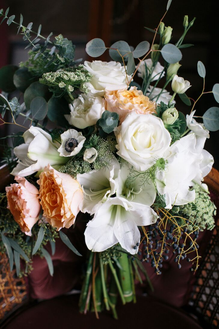 Gillian carried a rustic bouquet of seeded eucalyptus, privet berries, white anemones, white amaryllis and peach roses by The Flower Kiosk.