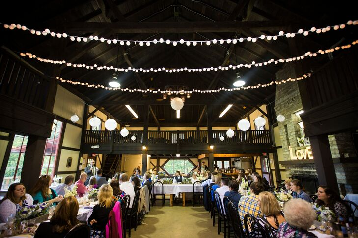 The reception took place inside the Optimist Lodge at Hoover YMCA Park, where lights were strung from above the rustic dining wood tables.