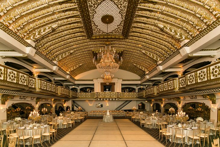 """Joe and I are both from Chicago, so it was only natural that we would get married here,"" Jordan says. The Grand Ballroom at Millennium Knickerbocker Hotel Chicago has a lot of gold touches, and the couple complemented this with lots of candlelight and metallic decor."