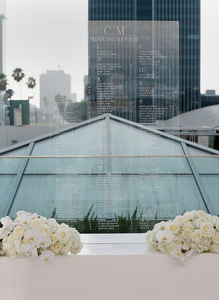 Acrylic seating chart at urban rooftop wedding