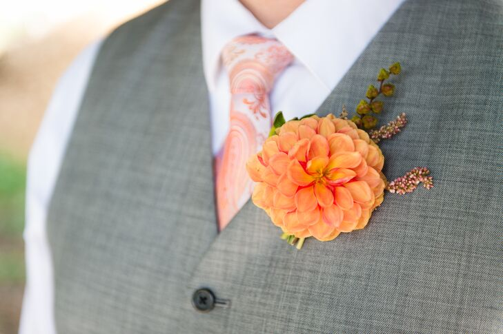 Ben's boutonniere was an orange dahlia, straight from a local dahlia farm in Washington State. To accessorize his gray suit, he chose a pink and orange paisley tie, which went perfectly with the couple's wedding color scheme.