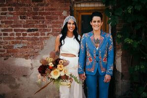Same-Sex Couple in White Jumpsuit and Blue Embroidered Custom Suit