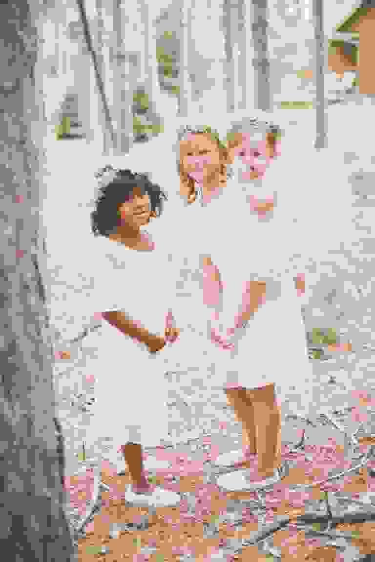 Flower girls before woodland wedding