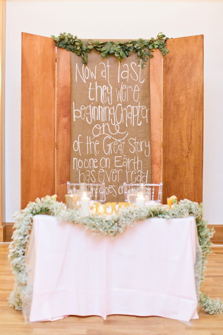 "One of the reception decorations was a custom wooden board, stained to match the ceremony arch that Brittany's dad made. The board was inscribed with a CS Lewis quote: ""Now at last they were beginning Chapter One of the Great Story which no one on earth has read: which goes on forever: in which every chapter is better than the one before."" The quote, Brittany says, ""represented that moment in our lives."""