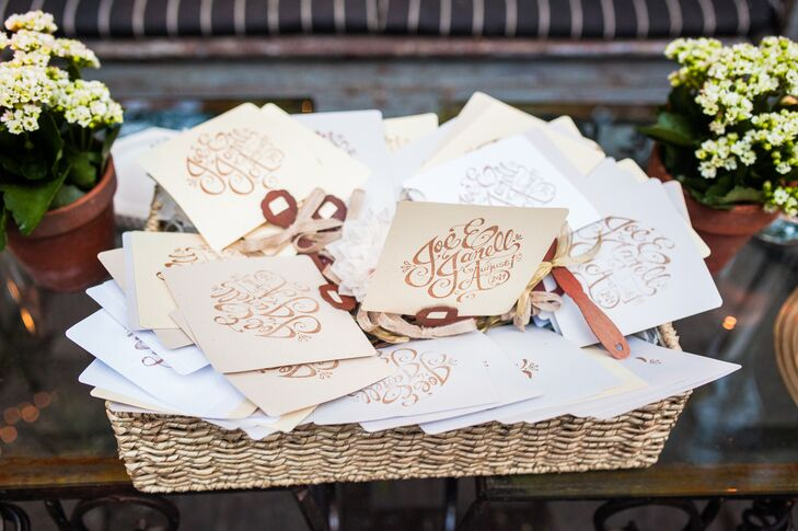 The couple designed their own logo and ordered a custom stamp off of Etsy that was used to decorate the handmade paper fans for the ceremony.