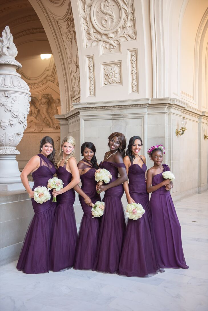 """Beth's five bridesmaids and one junior bridesmaid wore long purple dresses, a hue that Beth knew would """"complement each skin tone."""" As a bridesmaid gift, she presented each lady with crystal earrings before the ceremony."""