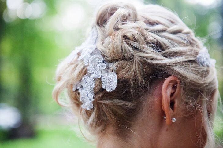 Hairstylist Stacy Brown used leftover lace applique from the bride's dress and incorporated it into a braided bridal updo.