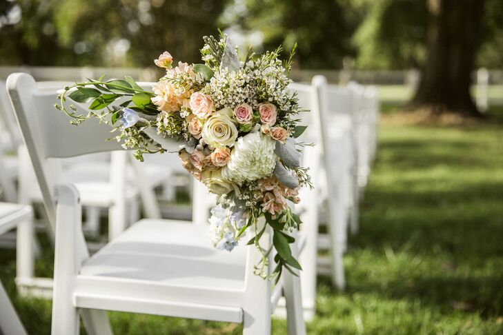 The ceremony aisle was decorated with peonies, roses, lamb's ear and wildflowers for an organic vintage look.