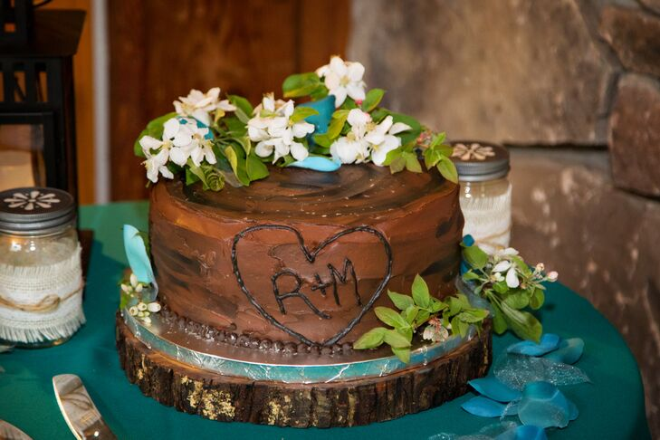 While Rachel and Mark had a playful log-shaped cake with an initialed carved heart made for the cake cutting, they decided against serving cake for dessert, treating guests to a decadent ice cream bar instead. Guests could customize their sweet treats with several flavors of ice cream and a variety of toppings, including cookies.