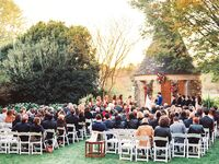 Outdoor wedding ceremony under rustic gazebo