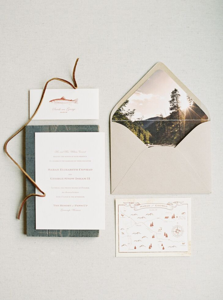 "Noteworthy designed rustic, vintage-inspired invites for Sarah and George. ""The invitations had a vintage-looking map of northwest Montana with a print of a brown trout on the band,"" Sarah says. ""A photo of Rock Creek, a river outside Missoula, was printed inside the envelope."""