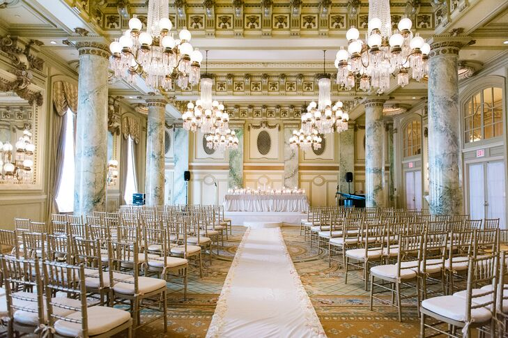 The ceremony took place in the ballroom at the Willard InterContinental in Washington, DC. The space was arranged with gold chiavari chairs and a white ceremony aisle down the center. Jackie and Donovan had a traditional Lutheran ceremony and a unity-candle ceremony. The row of candles at the altar echoed the beautiful chandeliers that hung above the space.