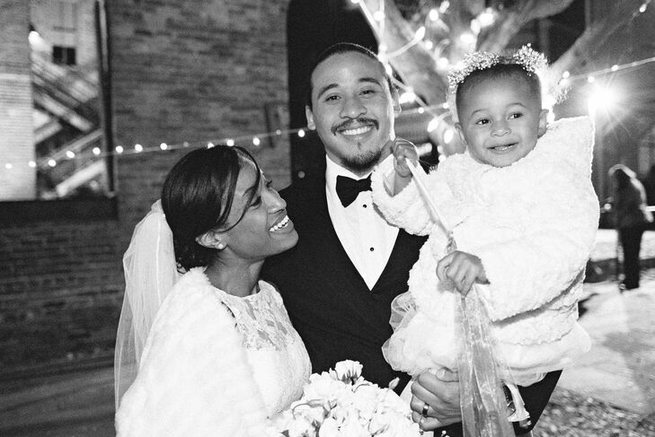 Happy Newlyweds with Their Daughter