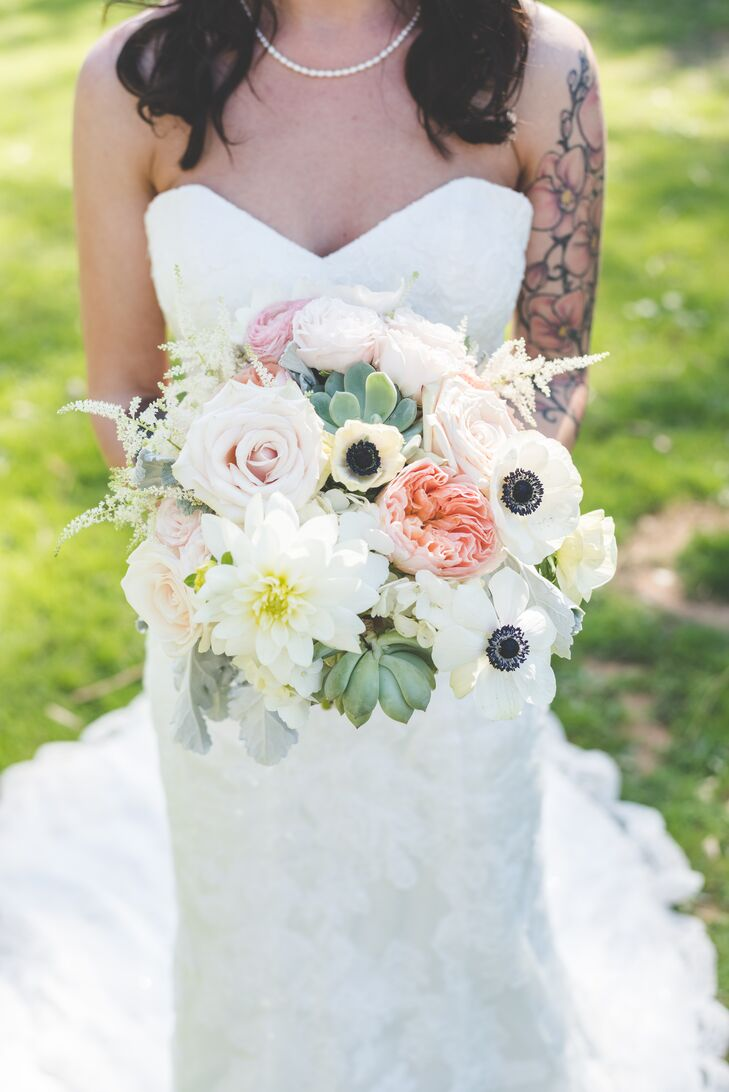 Sarah held an ivory, green and pink bouquet filled with chrysanthemum, roses, anemones and succulents.