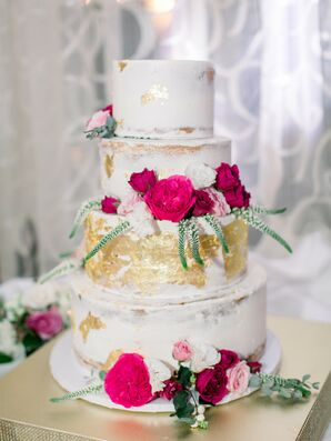Four-Tier Wedding Cake with Pink Flowers and Gold Leaf