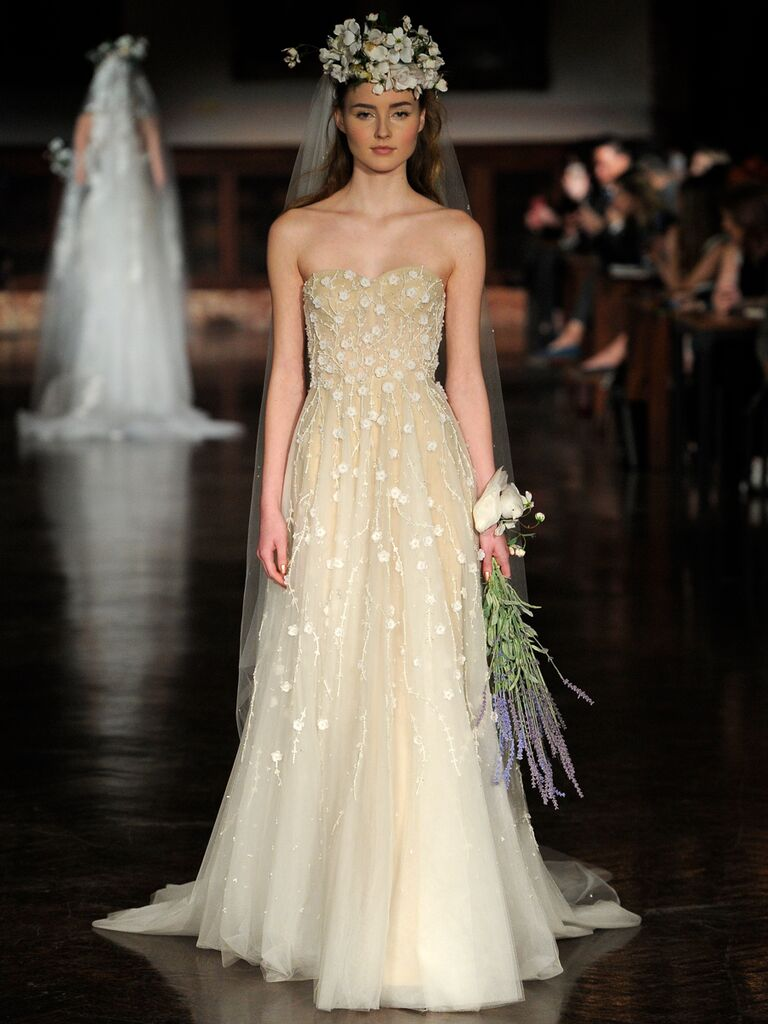 Reem Acra Spring 2019 nude wedding gown with floral appliqués