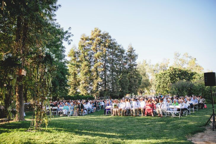 """""""Our wedding took place in the country at my parent's farm. The ceremony took place next to a pond in front of the same home I was brought to on the day I was born,"""" says Anna. """"I chose it because I love this land, and it is where I can sighrnand say """"I am home."""",""""rn"""