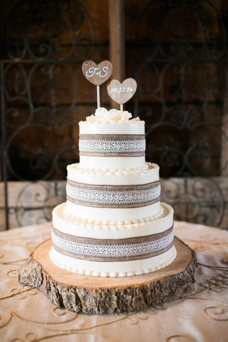 Sarah and Tim had a three-tier marble wedding cake with layers of raspberry and chocolate and wrapped in burlap and lace.