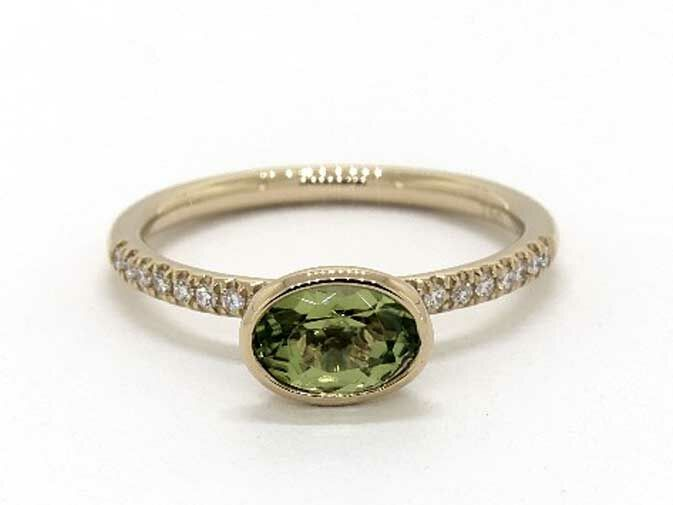 East west green peridot oval engagement ring