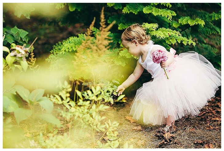 """""""Our flower girl, my niece,  was only a year and a half at the time of our wedding, so instead of entrusting her with a basket of flowers I just gave her a peony from my bouquet to hold,"""" says Emily. """"That child would not put the peony down all evening!"""""""