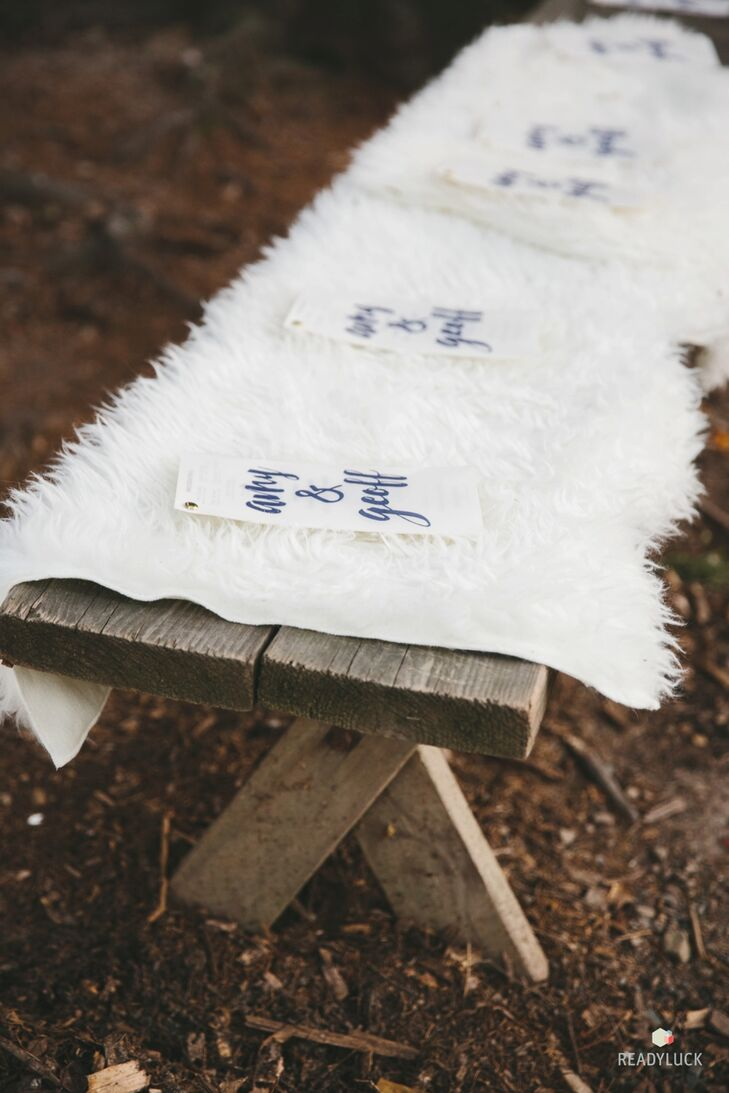 Rustic wooden ceremony benches were softened with faux fur.