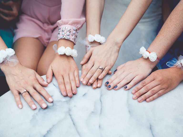 Girlfriends getting manicures to celebrate engagement