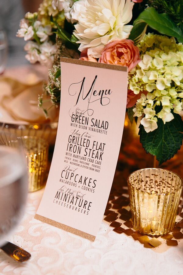 The menu cards at each seat coordinated with the other paper good at the wedding, featuring the same shimmery gold trim. Centerpieces were arranged on gold sequined placemats, adding some pizzaz to the dining tables.