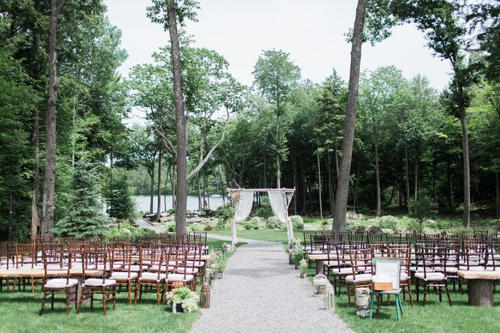 "The ceremony took place at 3:30 in the afternoon on the grounds of the estate overlooking the lake, with two large oak trees framing the spot where the couple would their ""I do's."" Molly's father and stepmother created a large birch tree arbor for the occasion, which they draped with lace curtains belonging to Molly's grandmother and fresh bunches of peonies, roses and ferns. Birdcages, tree stumps, lanterns and metal planters filled with poppies, succulents, dahlias and hydrangeas lined the aisles and Molly's uncle performed a rendition of ""Somewhere Over the Rainbow"" and ""What a Wonderful World"" on his ukulele for the processional. ""The ceremony itself was non-religious and focused on the friendship and companionship that a marriage brings, as well as the joining together of friends and families,"" says Molly."