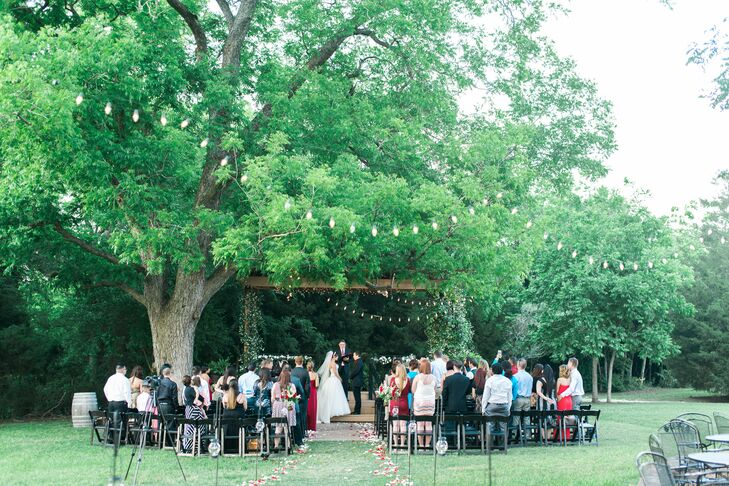 Laura and Matthew's wedding ceremony felt like it was straight out of Tuscany, surrounded by the lush winery and illuminated by string lights. Red and white rose petals down the aisle added romance to the space.