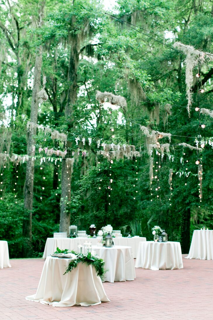 Suspended over the dance floor was a display of twinkle lights draped in Spanish moss and flowers. The handmade installation added a dreamy feel to the reception, and the subdued lighting created the romantic environment Jamie wanted.
