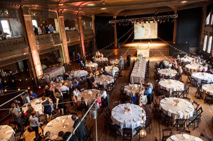 Amber and Andy's wedding reception at the Turner Ballroom featured romantic and rustic elements: The warm lighting and blush colors lent themselves to the former, while the wooden surroundings added to the latter.