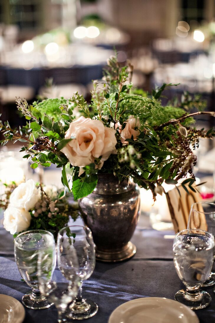 Rustic blooms were arranged in pewter vases for a rustic old world feel.