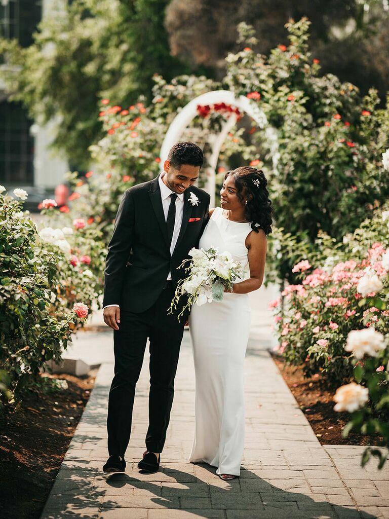 Bride holding monochrome white bouquet at summer wedding