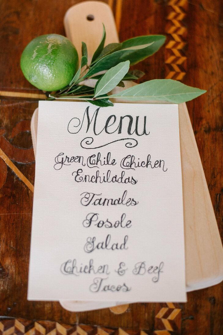 Each menu card was hand calligraphed on textured ivory paper for a rustic look. The menus were then displayed on wood boards accented with a bright green lime and fresh lime leaves.