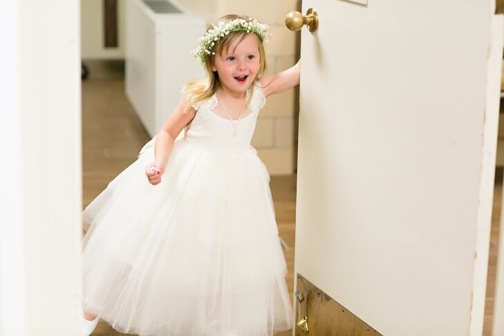 Kaitlynn and Ty's flower girl couldn't have been cuter! She wore a white dress with lace-cap sleeves and a full tulle skirt, with a baby's breath flower crown to top off her sweet style.