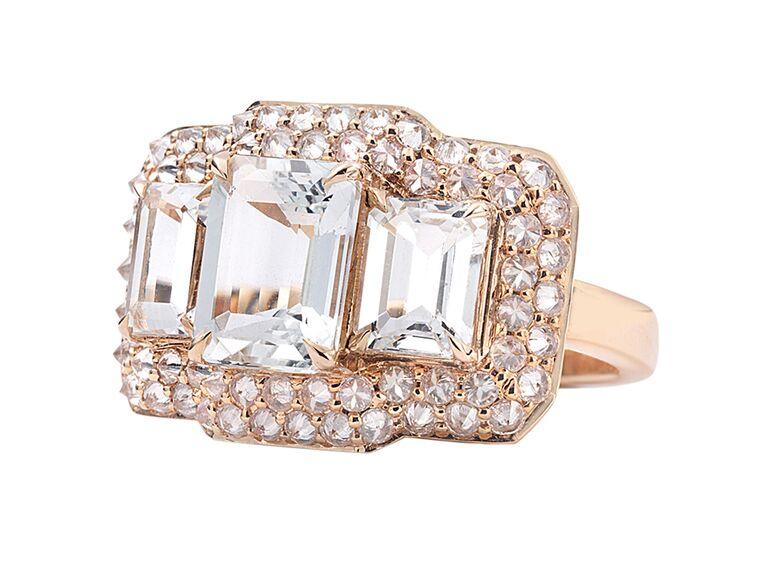Aquamarine three-stone engagement ring with double halo