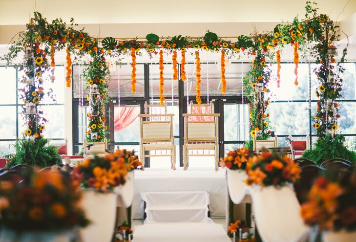 The bright ethnic colors of the fall season pop against the white linen at the ceremony venue.