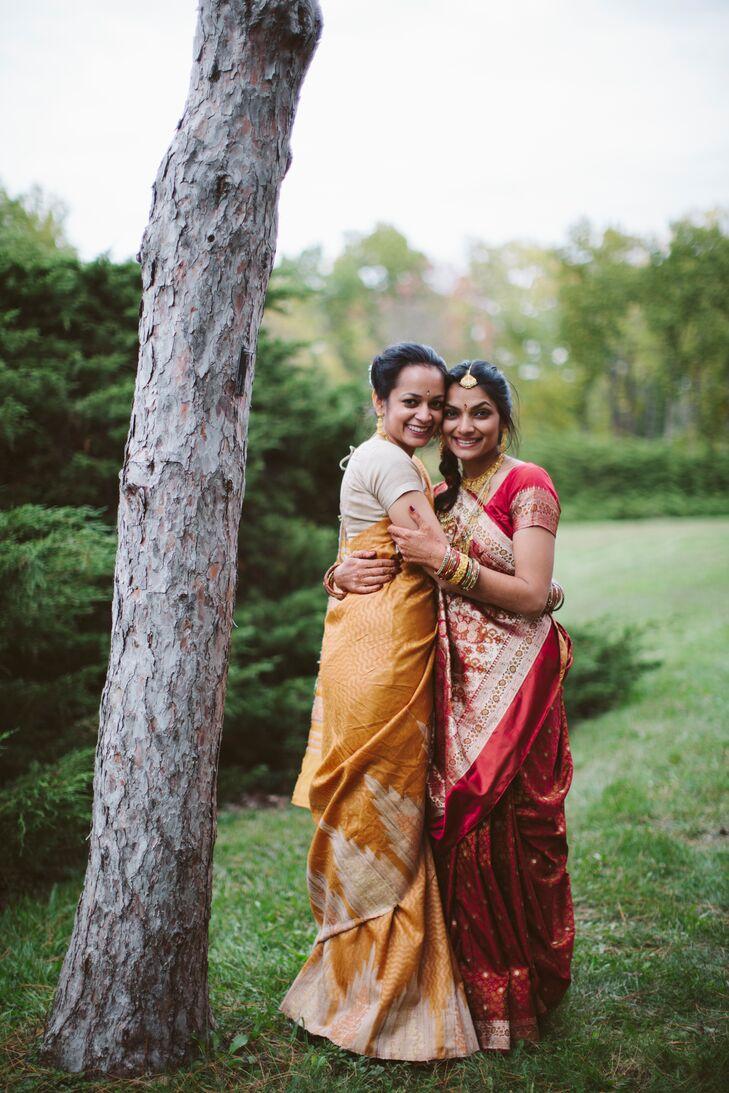 Bride Smiles and Embraces Bridesmaid