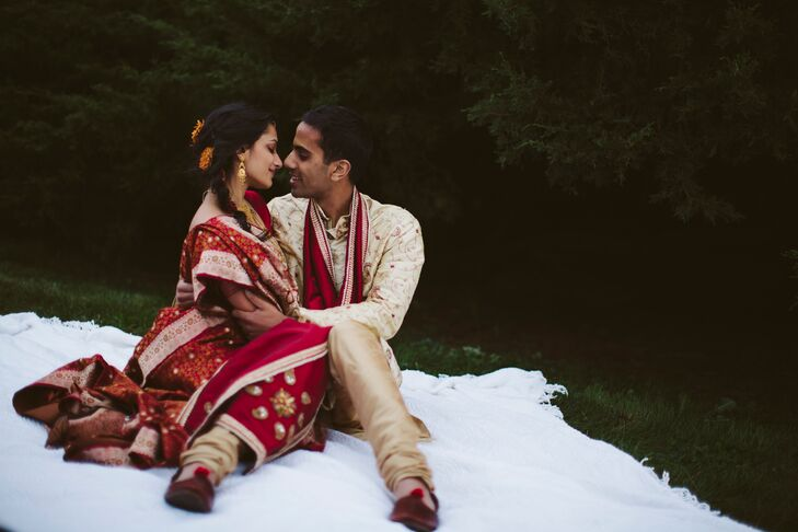 Bride and groom are enjoying their wedding photo session on a clean white cotton blanket
